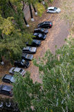 Passeger cars in the parking lot in a residential area. Cars are parked on parking in the residential area Stock Photography
