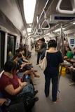 Passeggeri nel sottopassaggio Singapore dell'automobile Fotografia Stock Libera da Diritti