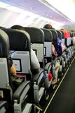 Passeggeri nella cabina dell'aeroplano Immagini Stock