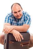 Passeggero annoiato con bagagli Fotografia Stock