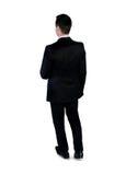 Passeggiata dell'uomo di affari indietro Fotografia Stock