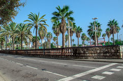 Passeig de Colom promenade at Barcelona city beach. Stone road fencing at the right side Royalty Free Stock Photo