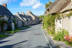 Passeio através de uma vila Foto de Stock Royalty Free