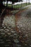 Passeio da pedra com cerca do ferro Imagem de Stock Royalty Free