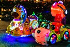 Passeios coloridos do Kiddie com luzes na noite - Turquia imagens de stock royalty free