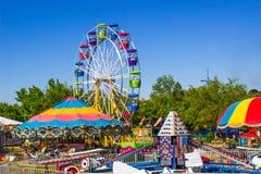 Passeios do carnaval na feira de condado pequena Fotografia de Stock