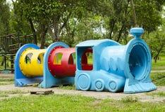 Passeios para o campo de jogos das crianças Imagem de Stock Royalty Free