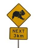 Passen Sie heraus für Koala in folgenden 3 Kilometern roadsign auf Stockfoto