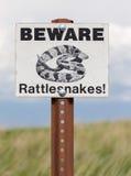 Passen Sie vom Klapperschlangen-Zeichen auf Stockfotografie