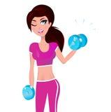 Passende Frau des Brunette, die mit Gewichten trainiert Lizenzfreie Stockfotos