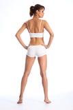 Passende Karosserie der jungen gesunden Frau in der weißen Unterwäsche Stockfotografie