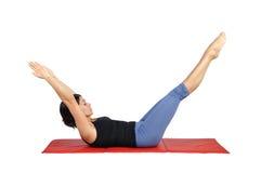 Passender junger weiblicher pilates Ausbilder Stockbilder