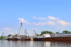 Passengeer liners, cargo ships and cranes Stock Image