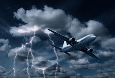 Passenger aeroplane passing thunderstorm Royalty Free Stock Images