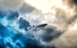 Passenger aeroplane throught turbulent thunderstorm and lightnings stock image