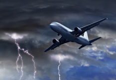 Passenger air plane approaching thunder storm Stock Photography