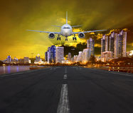 Passenger air plane landing in urban airport Royalty Free Stock Photos