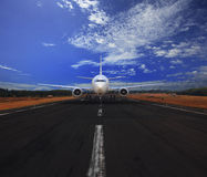 Passenger air plane running on airport runway with beautiful blue sky with white cloud use for transport and traveling journey bac Royalty Free Stock Photos