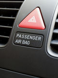 Passenger airbag switch. Close up of car interior showing the passenger airbag switch and hazard button Royalty Free Stock Images