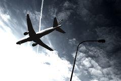 Passenger aircraft. The lamp and cloudy sky Stock Images