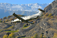 Passenger aircraft. A 12 seater passenger aircraft comes in to land in the mountains. Pilatus PC-12 NG Stock Photography