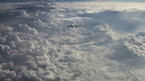 Passenger aircraft above the clouds stock video