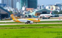 Passenger aircraft Airbus A320 of Scoot prepare taking off from Tan Son Nhat International Airport Stock Photo