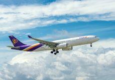 Passenger aircraft airbus A330 of Thai Airways fly in sky prepare to landing at Tan Son Nhat International Airport Royalty Free Stock Photography