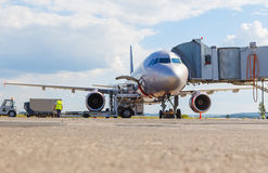 Passenger aircraft is being preparing for flight. Passenger aircraft is being preparing for a flight Royalty Free Stock Photo