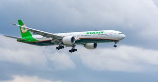 Passenger aircraft Boeing 777 of Eva Air fly over urban areas prepare to landing at Tan Son Nhat International Airport Stock Images