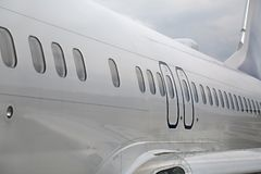 Airliner fuselage closeup. Passenger aircraft detail at an airport Stock Images