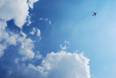 Boeing Passenger aircraft in flight. Boeing Passenger aircraft flying in blue sky with cloudscape Stock Images