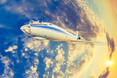 Passenger aircraft in flight Royalty Free Stock Photos
