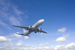 Passenger aircraft in flight Stock Image
