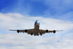 Passenger aircraft in flight Royalty Free Stock Images