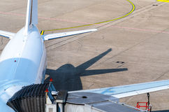 Passenger aircraft at the gate Stock Photography