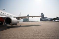 Passenger aircraft in Hong Kong International Airport royalty free stock photo