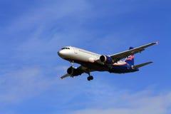 Passenger aircraft landing Stock Images