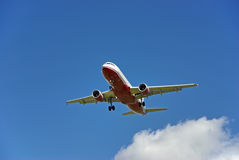 Passenger Aircraft Landing Stock Photo