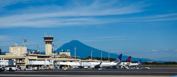 Passenger aircraft lined up at terminal at San Salvador Airport in Central America Royalty Free Stock Photo