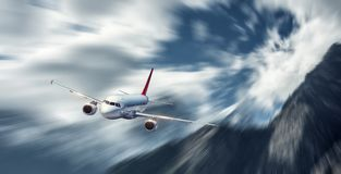 Passenger aircraft in motion. Modern airplane mith motion blur e Stock Images