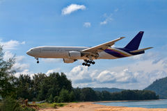 Passenger aircraft over the beach Royalty Free Stock Image