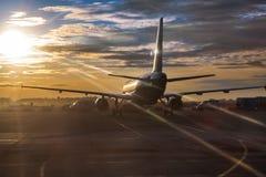 Passenger aircraft riding on runway Stock Photos