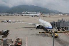 Passenger aircraft on the runway of Hong Kong. The Passenger aircraft on the runway of Hong Kong royalty free stock photos