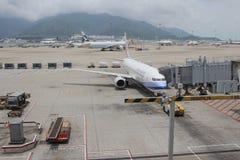 Passenger aircraft on the runway of Hong Kong. The Passenger aircraft on the runway of Hong Kong royalty free stock images