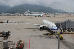 Passenger aircraft on the runway of Hong Kong. The Passenger aircraft on the runway of Hong Kong stock images