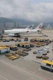 Passenger aircraft on the runway of Hong Kong. The Passenger aircraft on the runway of Hong Kong royalty free stock image