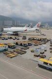Passenger aircraft on the runway of Hong Kong. The Passenger aircraft on the runway of Hong Kong royalty free stock photography