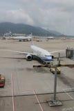 Passenger aircraft on the runway of Hong Kong. The Passenger aircraft on the runway of Hong Kong stock photos