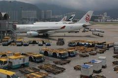 Passenger aircraft on the runway of Hong Kong. The Passenger aircraft on the runway of Hong Kong royalty free stock photo